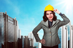 Asian woman holding hard hat Royalty Free Stock Images