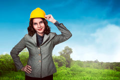 Asian woman holding hard hat Stock Photography