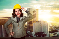 Asian woman holding hard hat Royalty Free Stock Photography
