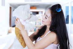 Asian woman holding her dog at home Royalty Free Stock Photos