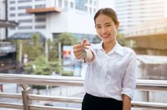 Asian woman holding home model keys smilling and happy stock photo