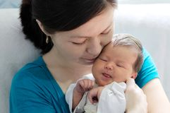 Asian woman holding infant baby. Asian women holding infant baby in her arms, happy motherhood Royalty Free Stock Photos