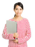 Asian woman holding laptop. Isolated on white royalty free stock images