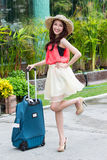 Asian woman holding luggage Royalty Free Stock Images