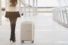Asian woman holding luggage for travel Stock Photos