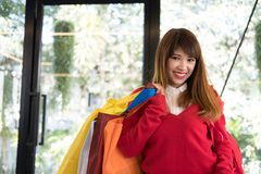 Woman holding many shopping bags. shopaholic, sale, consumerism. Asian woman holding many shopping bags. shopaholic, sale, consumerism and people concept Royalty Free Stock Photo