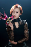 Asian woman holding mask of Royalty Free Stock Photo