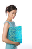 Asian woman holding a patterned folder Royalty Free Stock Photos