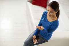 Asian woman holding pills and medicine in hand Stock Photos