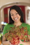 Asian woman holding a potted plant Royalty Free Stock Photography
