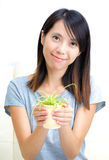Asian woman holding potted plant Stock Photos