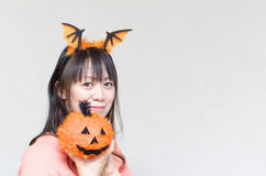 Asian woman holding a pumpkin Royalty Free Stock Images