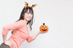 Asian woman holding a pumpkin Stock Photos
