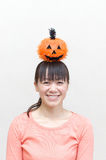 Asian woman holding a pumpkin Stock Photo