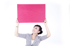 Asian woman holding a  red blank sign billboard. Beautiful Asian Woman showing red blank sign billboard isolated on white Stock Photo