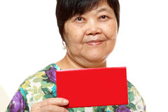 Asian woman holding a red card Stock Images