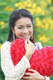 Asian woman holding a red heart Royalty Free Stock Photos