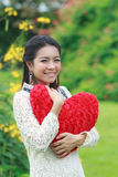 Asian woman holding a red heart Stock Image