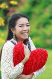 Asian woman holding a red heart Stock Photography