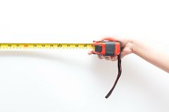 Asian woman holding red metering tool Stock Images