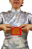 Asian woman holding red money packet or ang pow Royalty Free Stock Photo