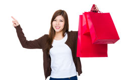 Asian woman holding with shopping bag and finger point up. Isolated on white background Royalty Free Stock Photo