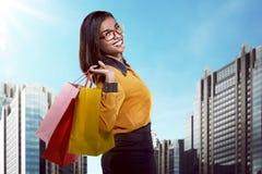 Asian woman holding shopping bag Royalty Free Stock Image