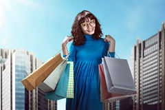 Asian woman holding shopping bag Royalty Free Stock Images