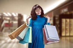 Asian woman holding shopping bag Stock Photo