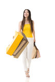 Asian woman holding shopping bags Royalty Free Stock Photo