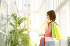 Asian woman holding shopping bags Royalty Free Stock Photography