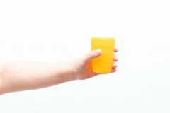 Asian woman holding a small plastic cup. Isolated Stock Images