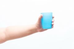 Asian woman holding a small plastic cup. Isolated Stock Photo