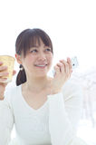 Asian woman holding a smart phone Royalty Free Stock Photo
