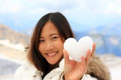 Asian woman holding a snowball Stock Photography