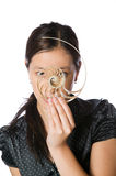 Asian woman holding a split nautilus shell Royalty Free Stock Photography