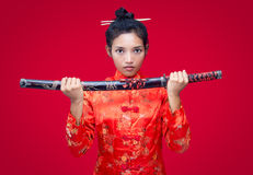 Asian woman holding a sword Stock Photography