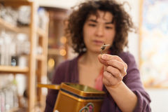 Asian woman holding a tea leaf Stock Photo