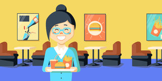 Asian woman holding tray full of junk food Royalty Free Stock Image