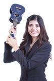Asian woman holding ukulele. Royalty Free Stock Photography