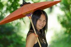 Asian woman holding umbrella Stock Photography