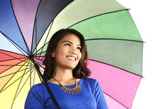 Asian woman holding umbrella smiling Royalty Free Stock Photo