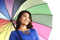 Asian woman holding umbrella smiling Royalty Free Stock Photo