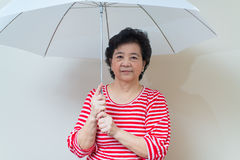Asian woman holding umbrella in studio shot, specialty tones Stock Images