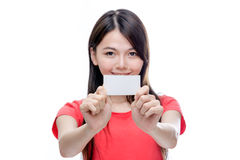 Asian woman holding up blank business card. Out of focus Chinese woman holding up blank business card Stock Photography