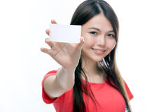 Asian woman holding up blank business card Royalty Free Stock Photos