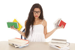 Asian woman holding up books Stock Photos