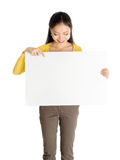Asian woman holding white blank paper card Royalty Free Stock Photo