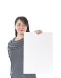 Asian woman holding white board Royalty Free Stock Photography