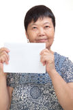 Asian woman holding a white card Royalty Free Stock Image